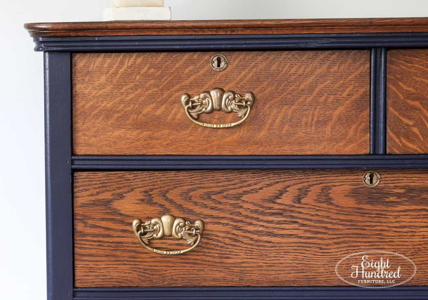 Corner shot of handles and refinished drawers in General Finishes Antique Walnut Gel Stain