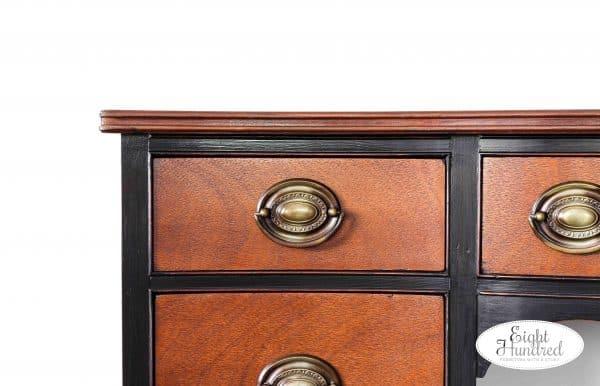 Corner view of Lamp Black Desk with Nutmeg Gel Stain drawers, hepplewhite handles, high performance topcoat