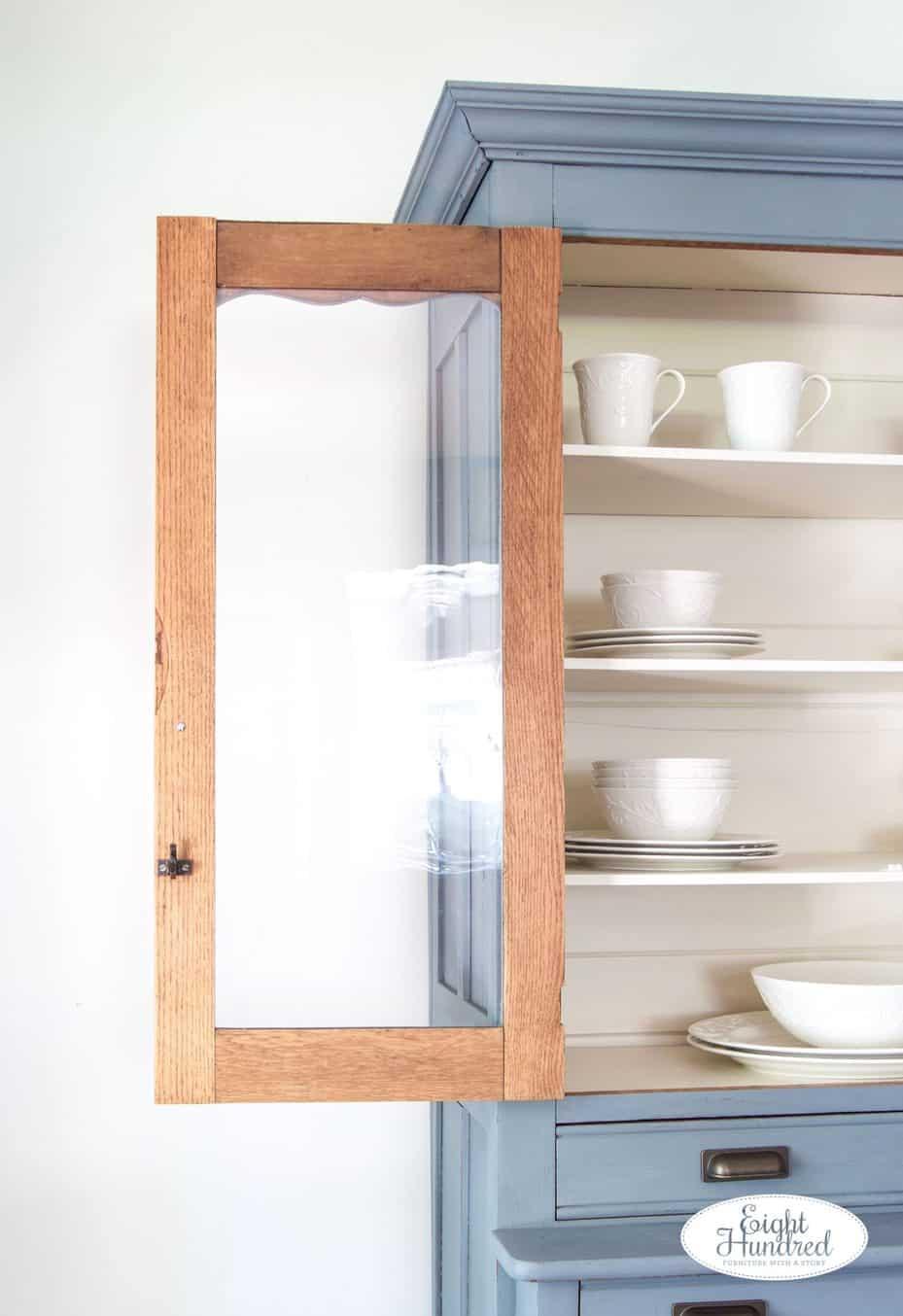 Wavy glass in aviary hutch, door of hutch