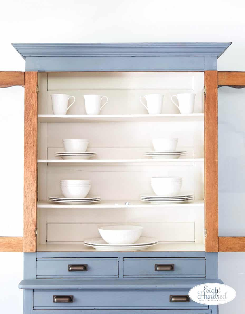 Open hutch with white dishes inside