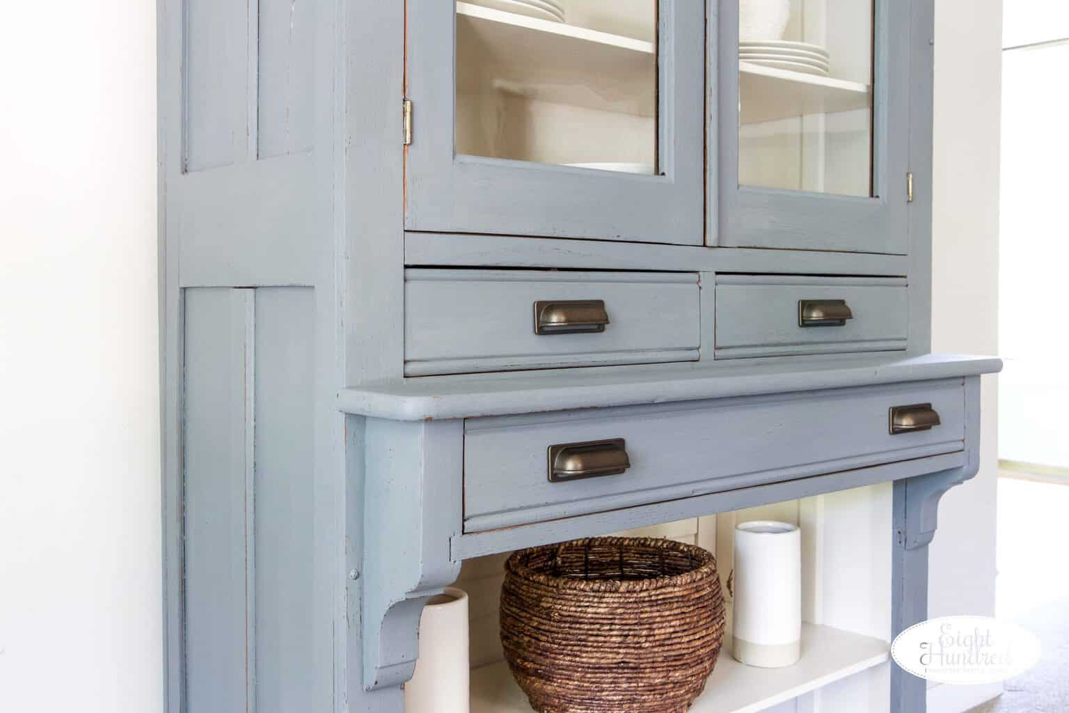 Close up of cup pulls on aviary hutch cabinet