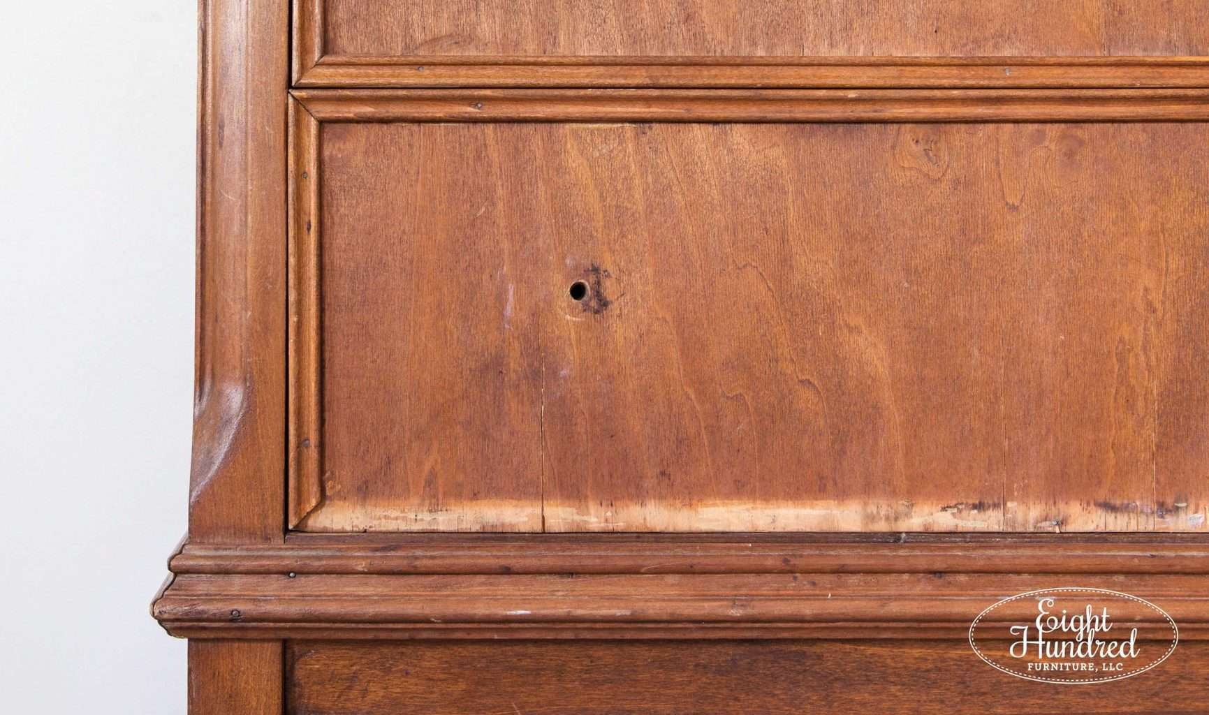 Close up of missing trim on the bottom drawer