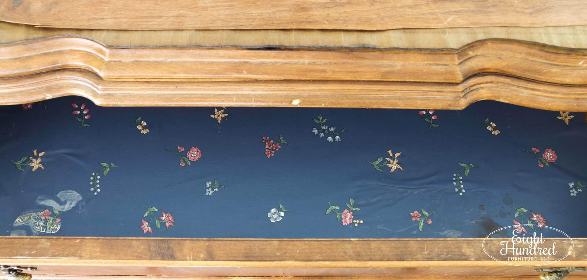 Vintage wallpaper drawer liner inside the baby buffet