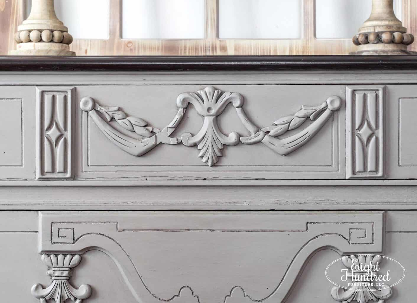 Close up on carved details on French Linen Chalk Painted dresser