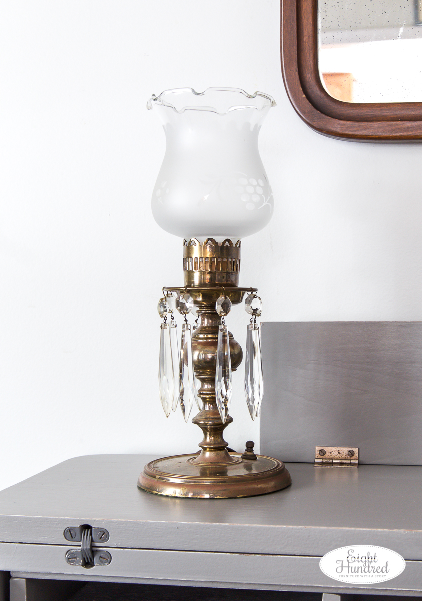 Crystal vintage lamp on spinet desk