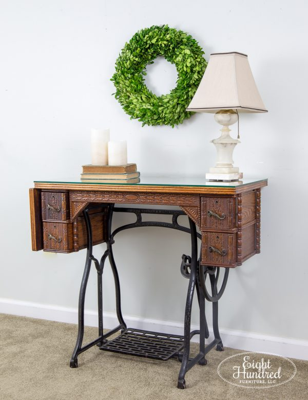 Side view of antique sewing table