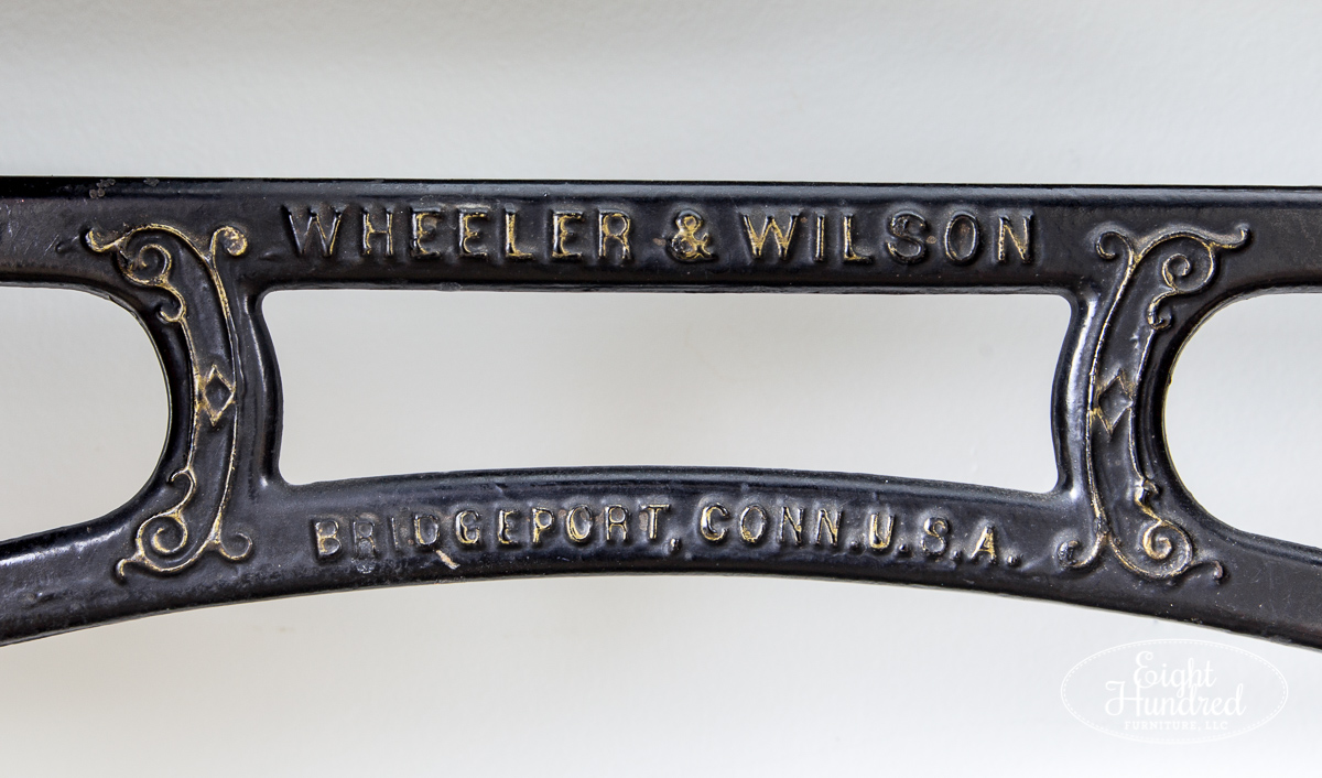 Wheeler & Wilson label on antique sewing table base