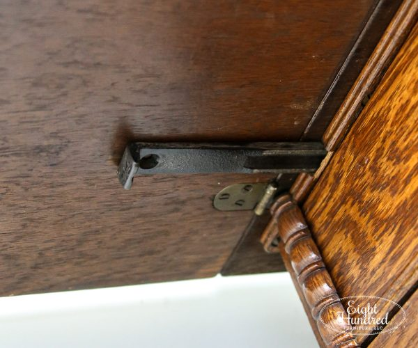 Latch for leaf extension on antique sewing table