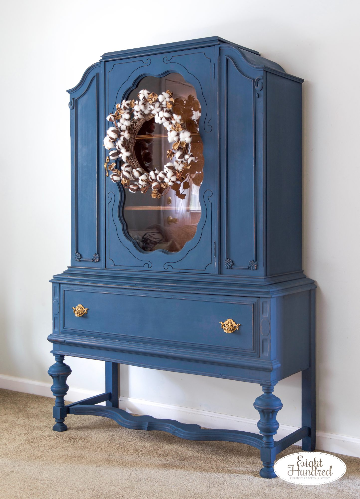 Side view of china cabinet painted in Flow Blue and Artissimo MMS Milk Paint by Eight Hundred Furniture