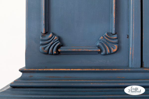 Close up of details and distressing on china cabinet painted in Flow Blue and Artissimo by Miss Mustard Seed's Milk Paint