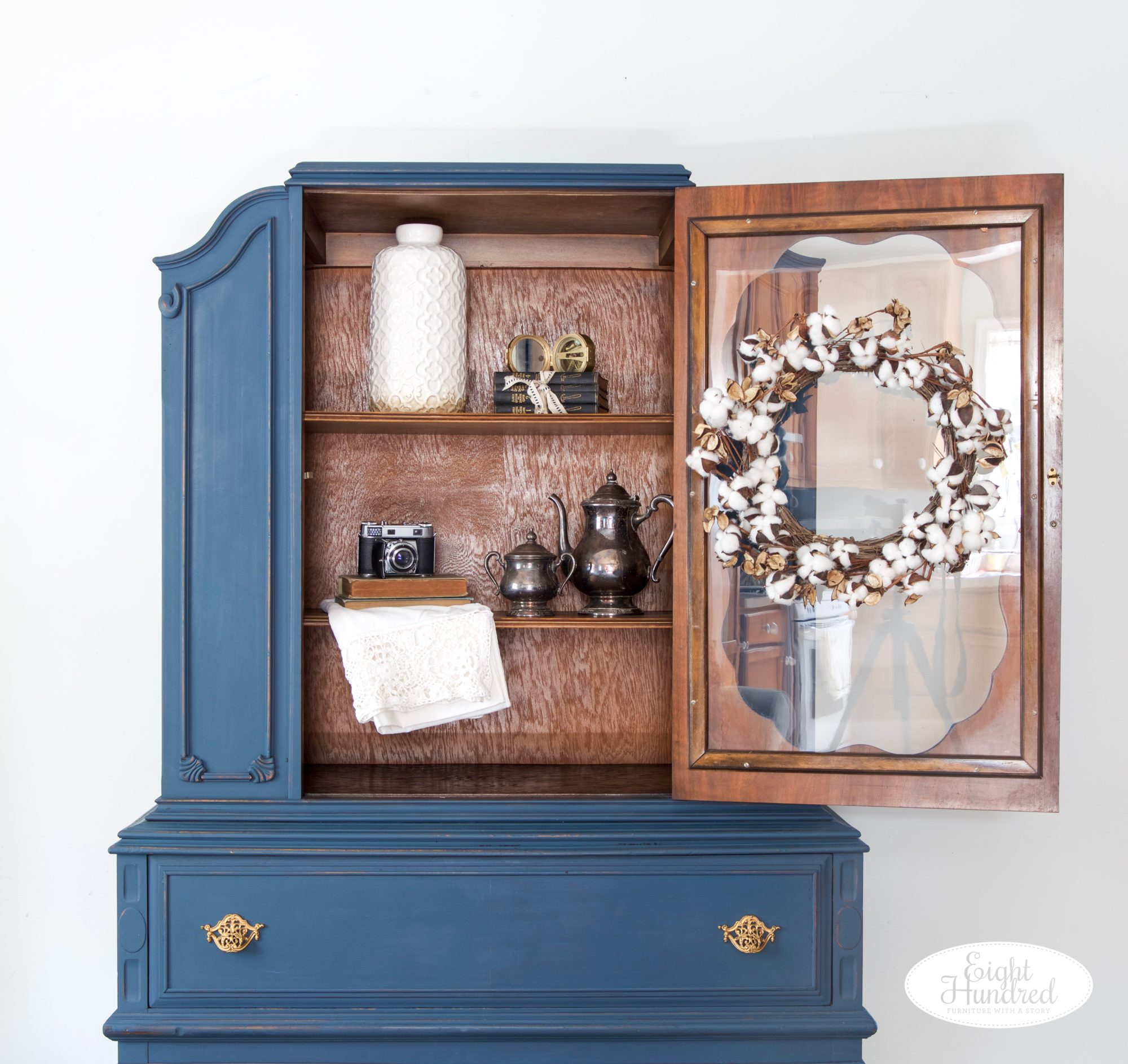 Staged inside of china cabinet painted in blend of Flow Blue and Artissimo by Miss Mustard Seed's Milk Paint