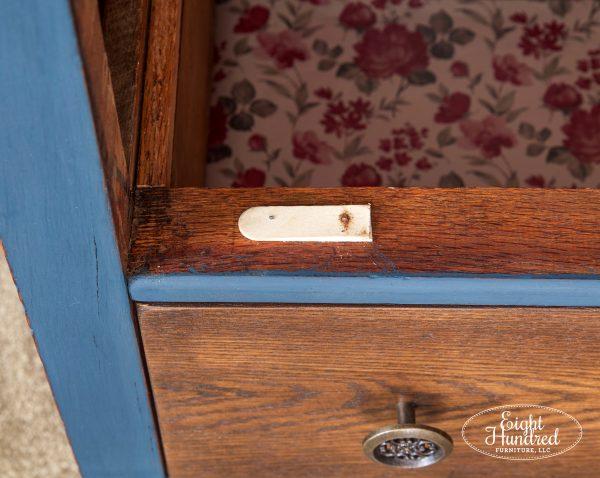 Close up of wood block fix on dresser drawer