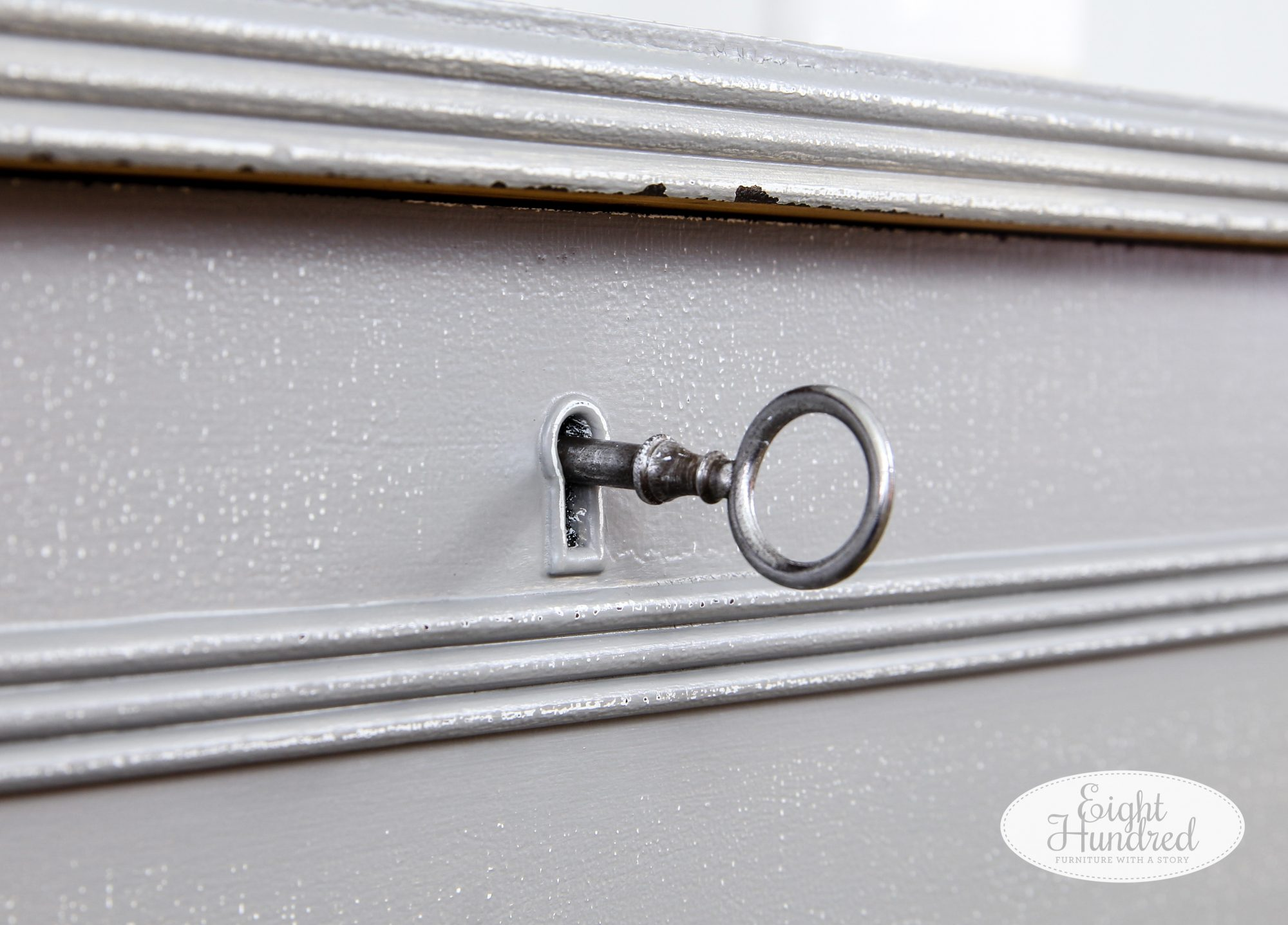 Original key in lock on vintage cedar chest painted in General Finishes Perfect Gray Milk Paint