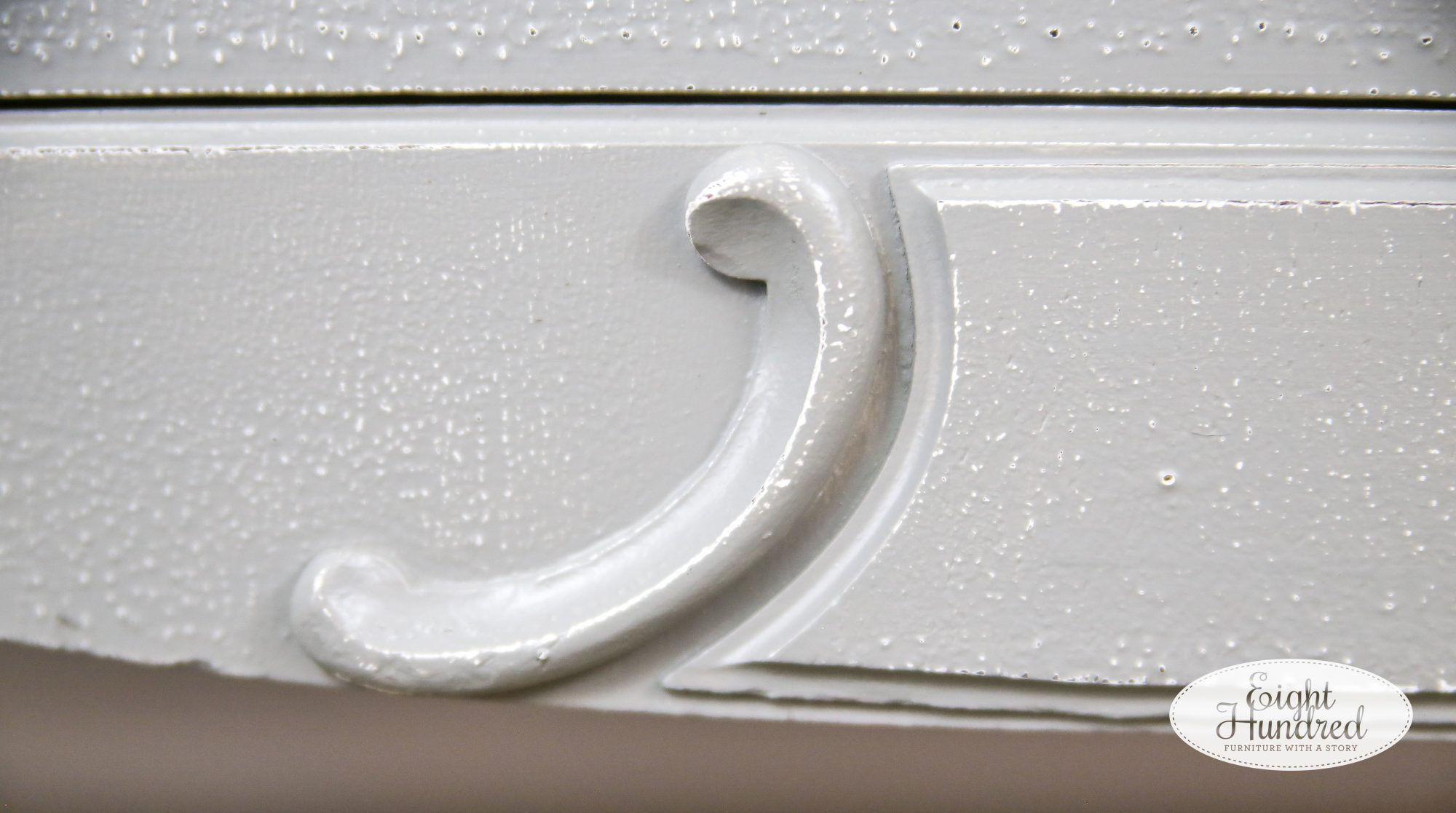 Curved detail on base of a vintage cedar chest painted in General Finishes Perfect Gray Milk Paint