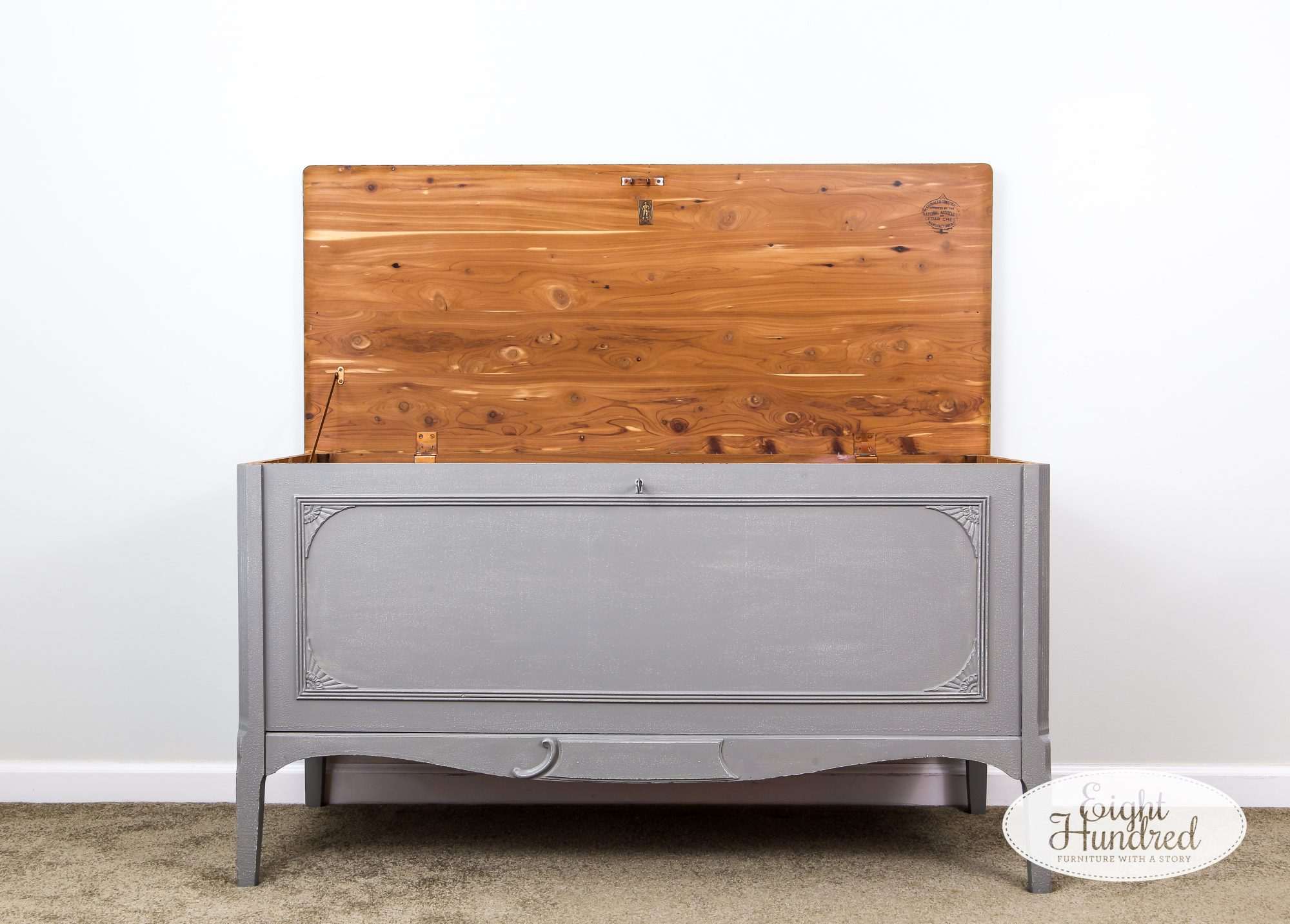 Vintage cedar chest painted in General Finishes Perfect Gray Milk Paint with the lid open