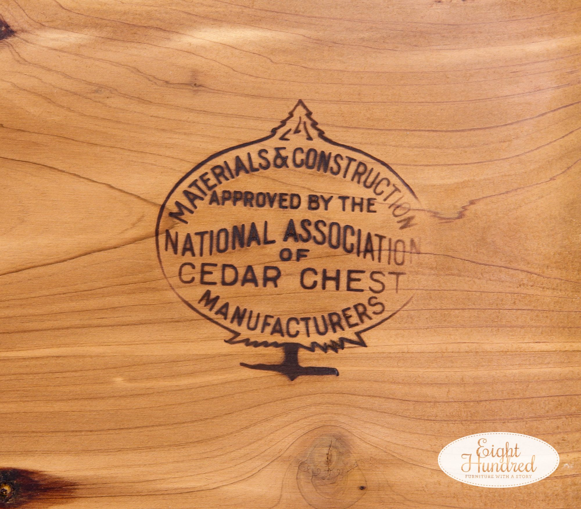 "Stamp inside the lid of vintage cedar chest that reads ""materials & construction approved by the national association of cedar chest manufacturers"""