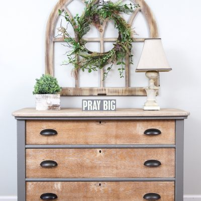 Front view of 3 drawer oak dresser with oil rubbed bronze cup pulls painted in Perfect Gray Milk Paint by General Finishes and whitewashed drawers.