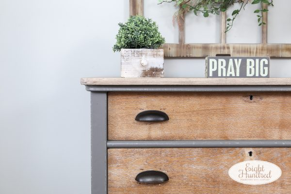 Corner of 3 drawer oak dresser painted in Perfect Gray Milk Paint by General Finishes with whitewashed drawers