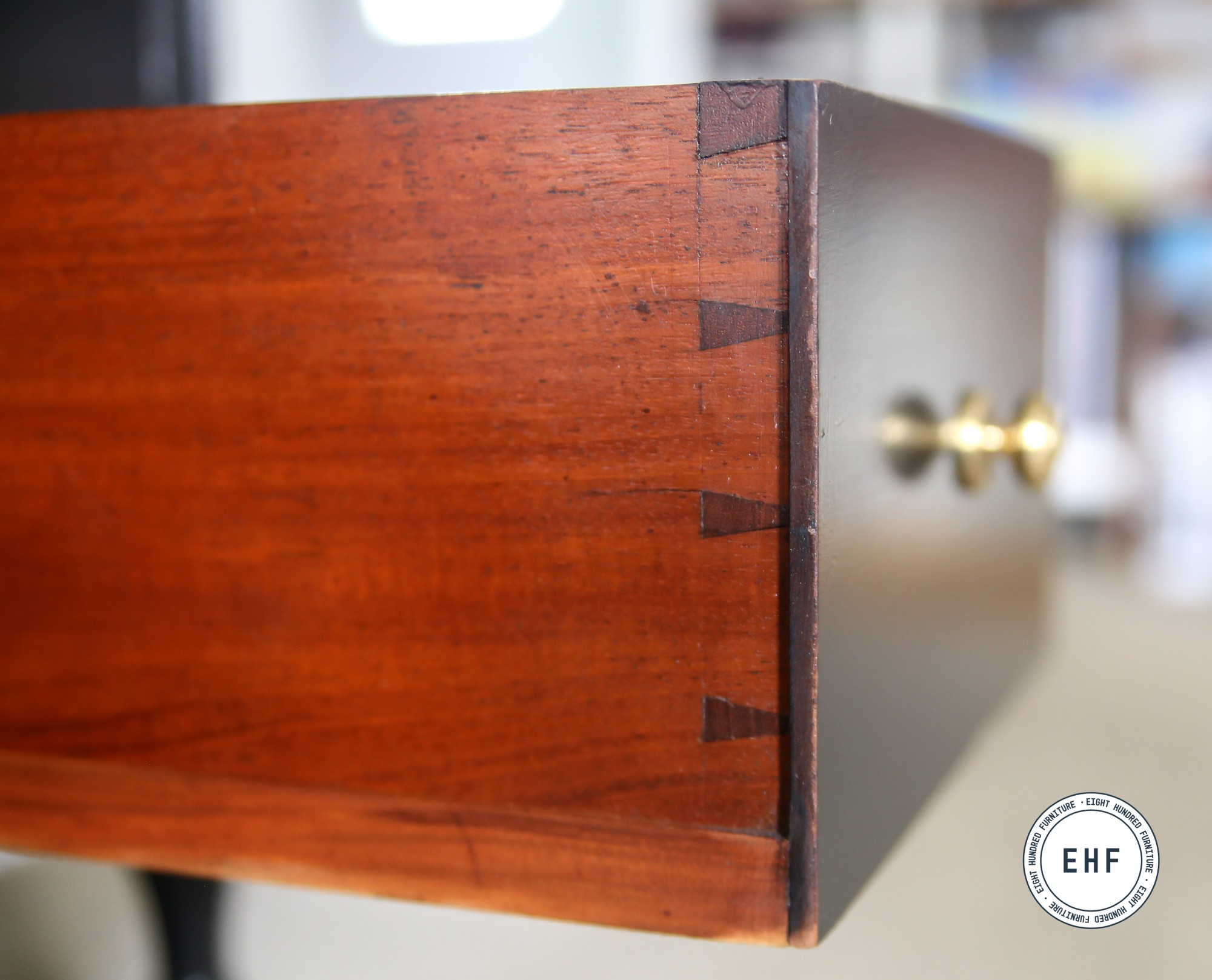Hand cut dovetails on mahogany desk drawer