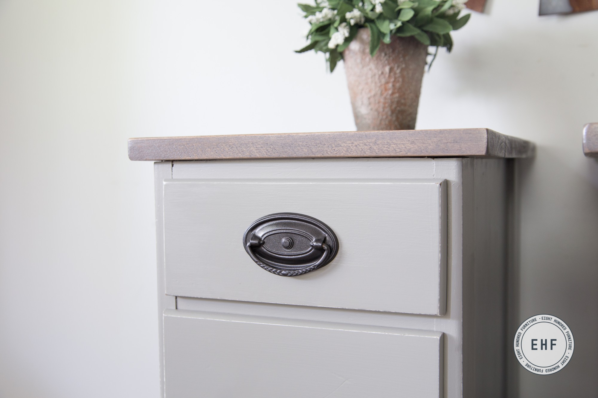 Side view of Hepplewhite handle on Empire Gray Milk painted nightstands by Eight Hundred Furniture