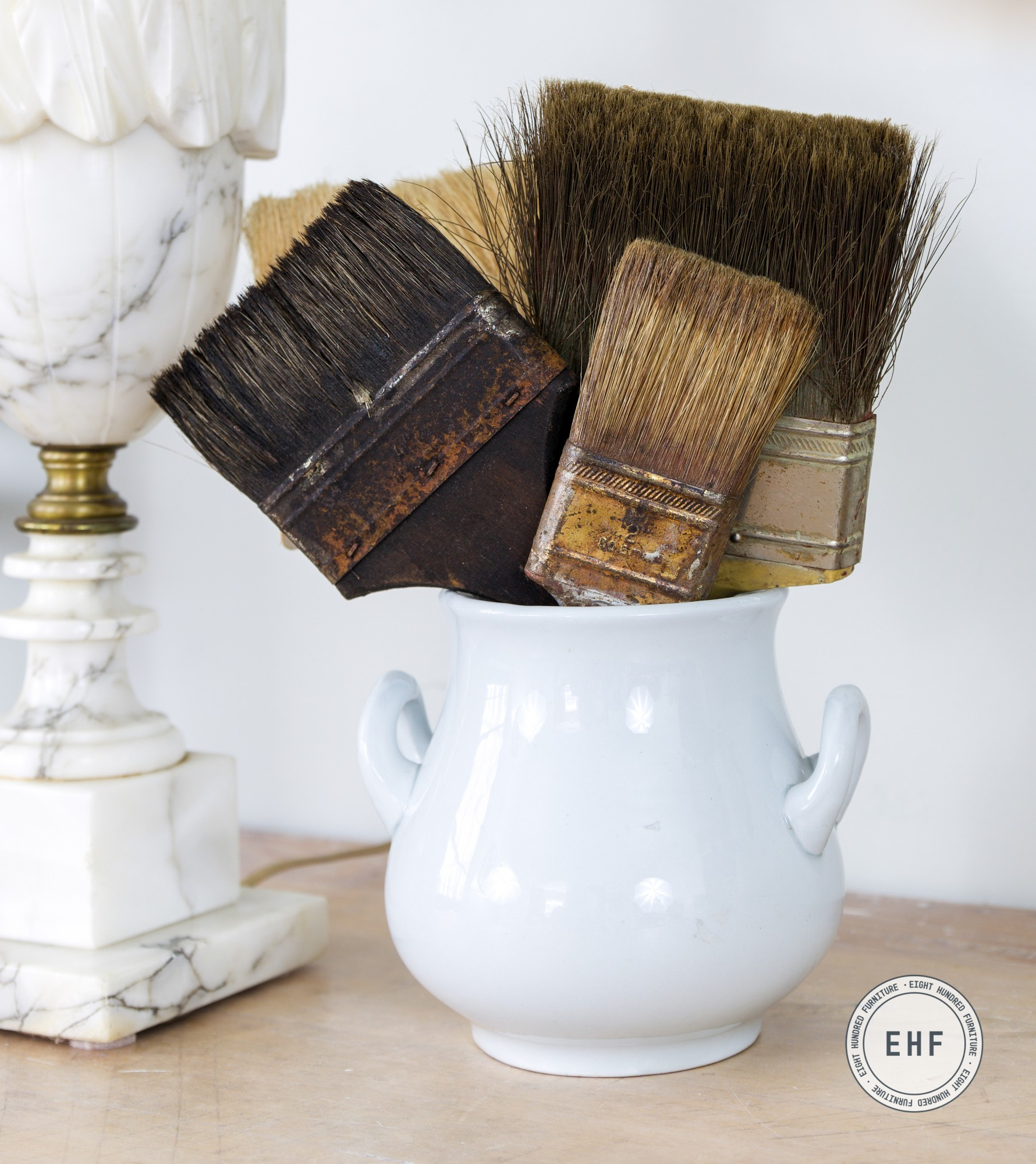 Old paint brushes in an ironstone sugar jar