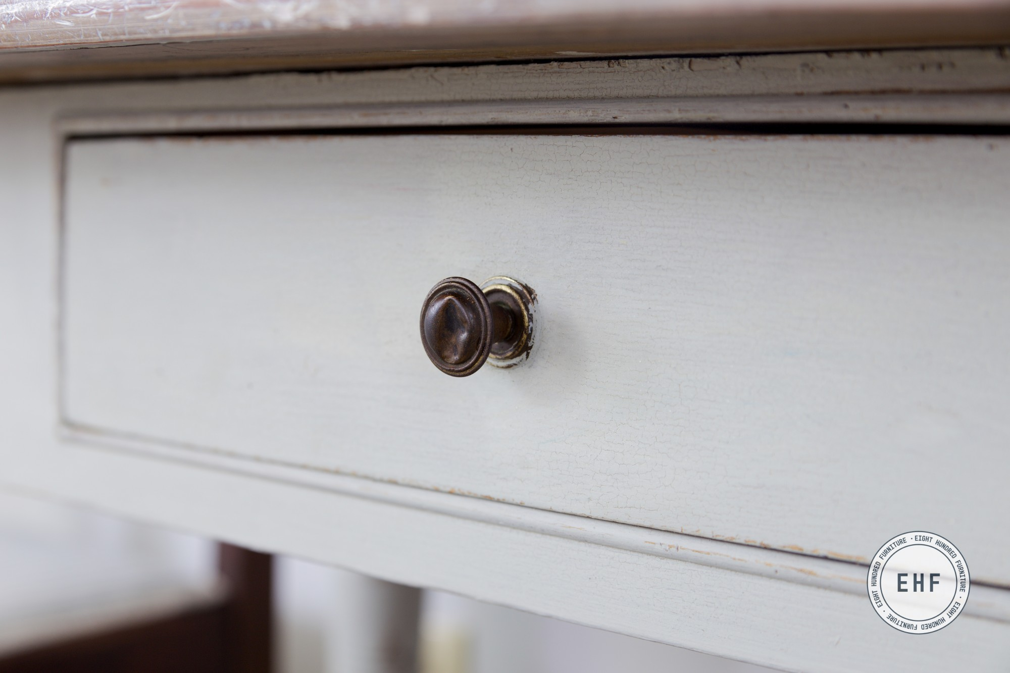 Drawer knob on antique desk painted in Mora by Miss Mustard Seed's Milk Paint