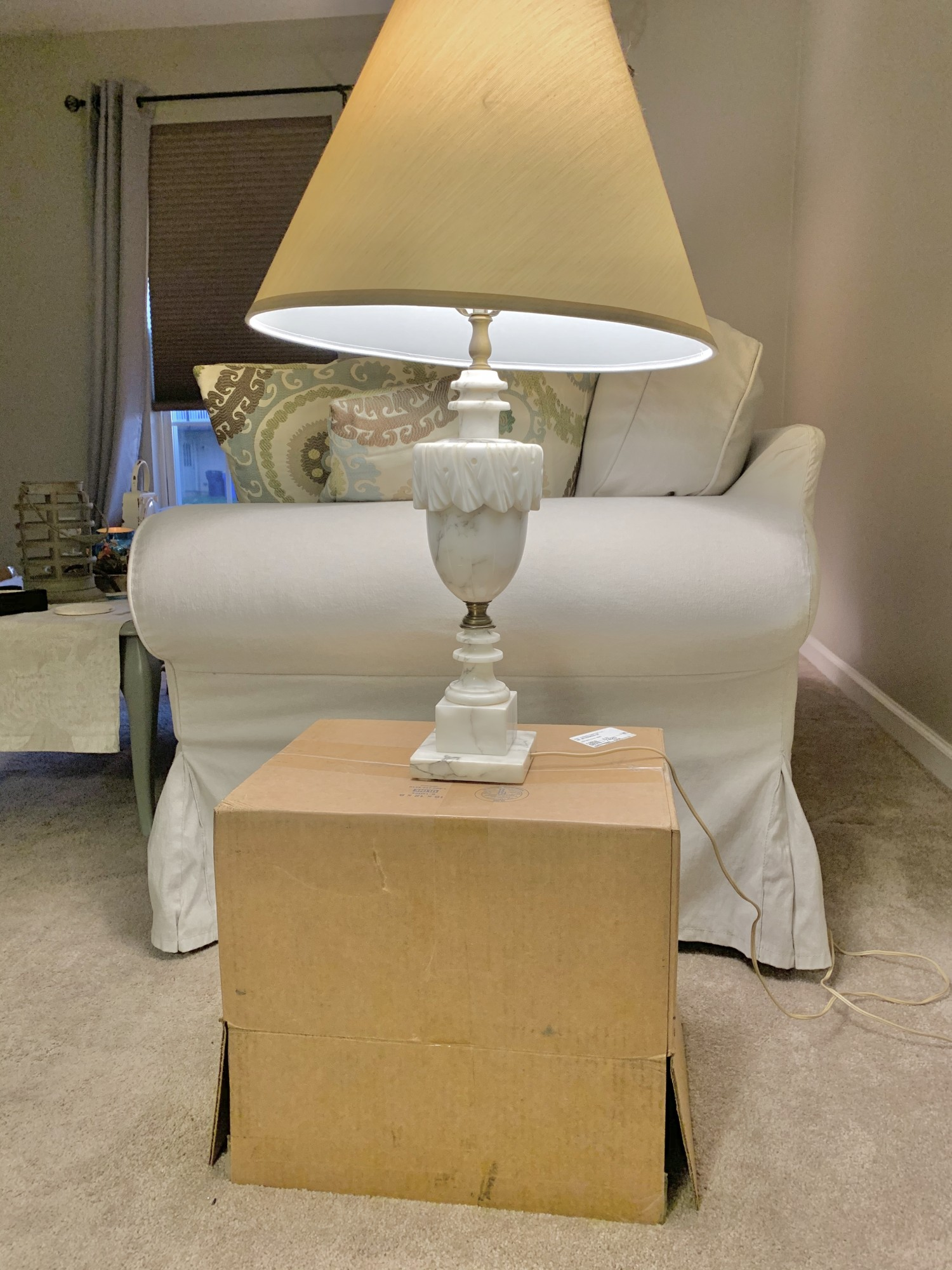 Alabaster lamp on a moving box end table