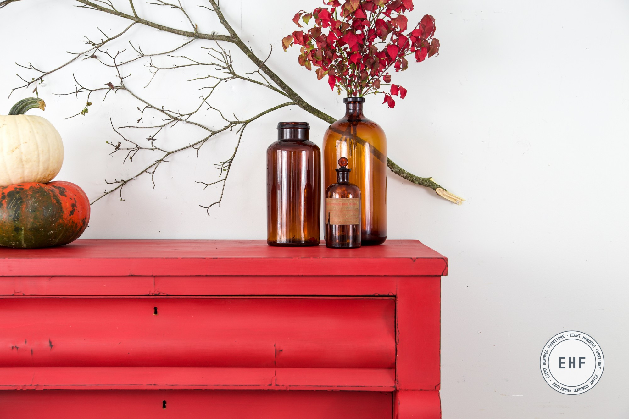 Cluster of amber bottles on empire dresser in Miss Mustard Seed's Milk Paint by Eight Hundred Furniture