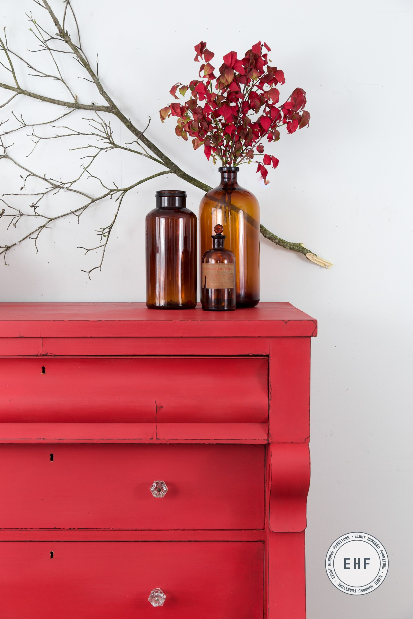 Amber bottles and fall decor on empire dresser in Miss Mustard Seed's Milk Paint by Eight Hundred Furniture