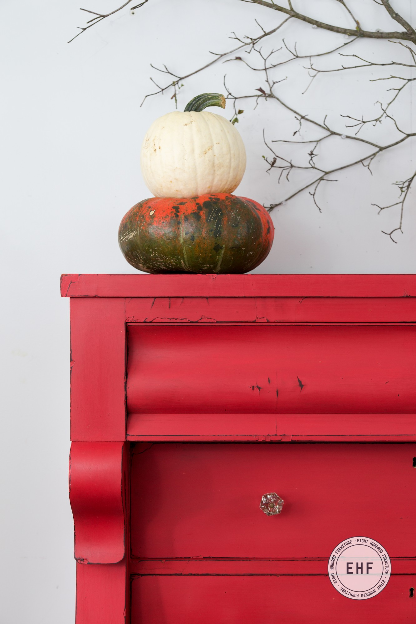 Stacked pumpkins on an empire dresser in Miss Mustard Seed's Milk Paint by Eight Hundred Furniture