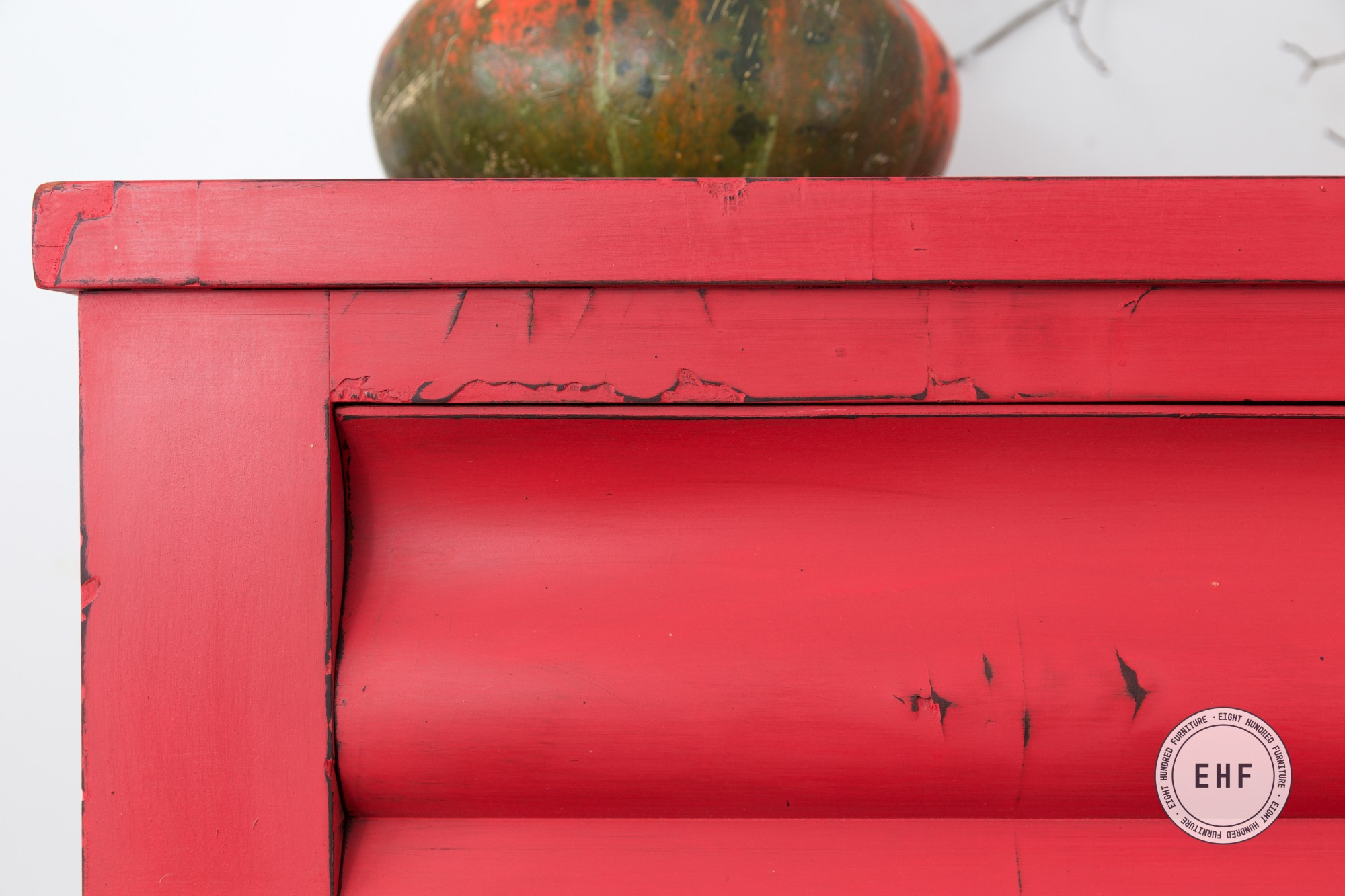 Distressing on an antique dresser with red/orange Milk Paint