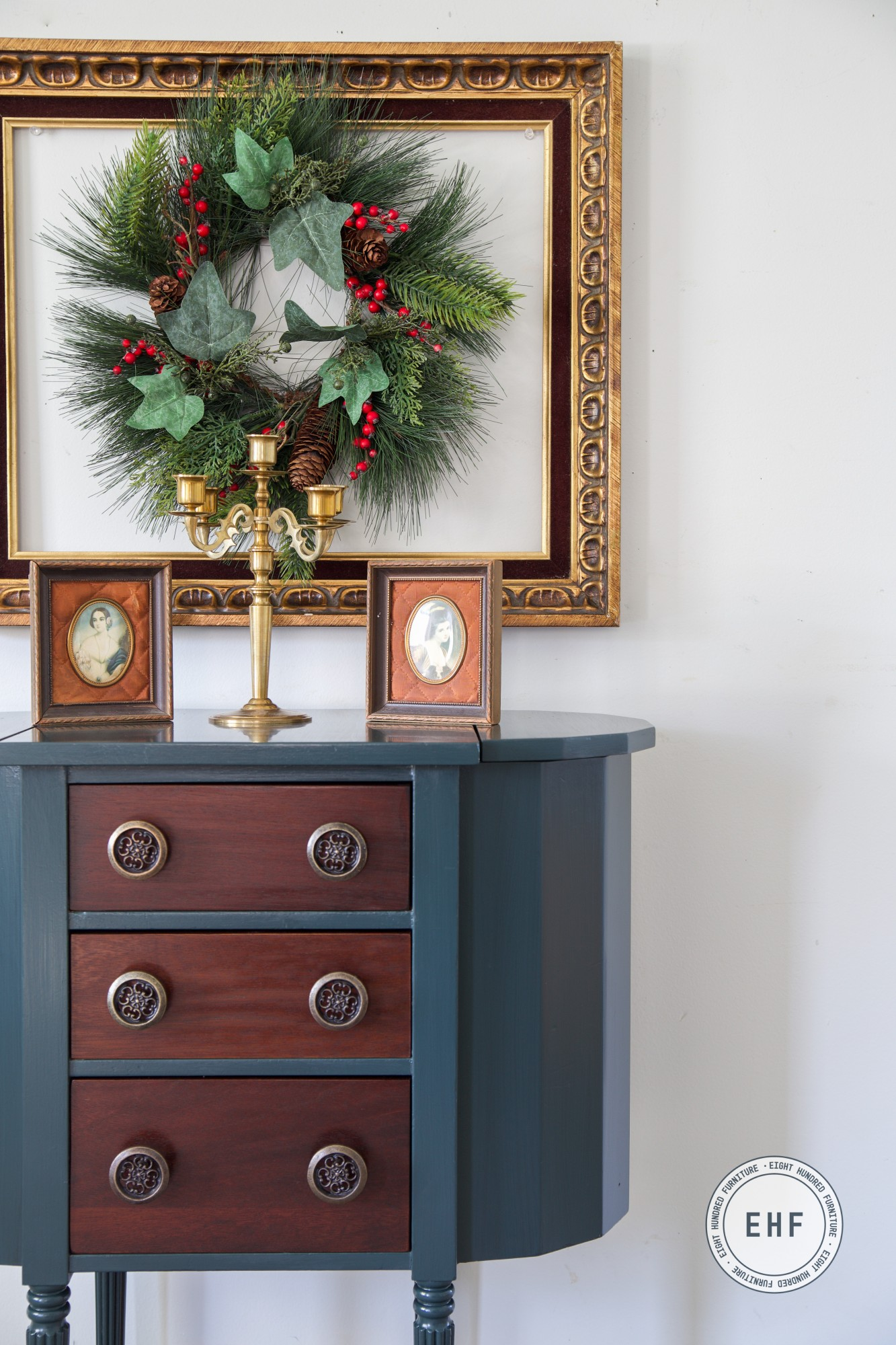 Gold frame with Christmas Wreath above green Martha Washington Sewing Table painted in custom mix of General Finishes Milk Paint