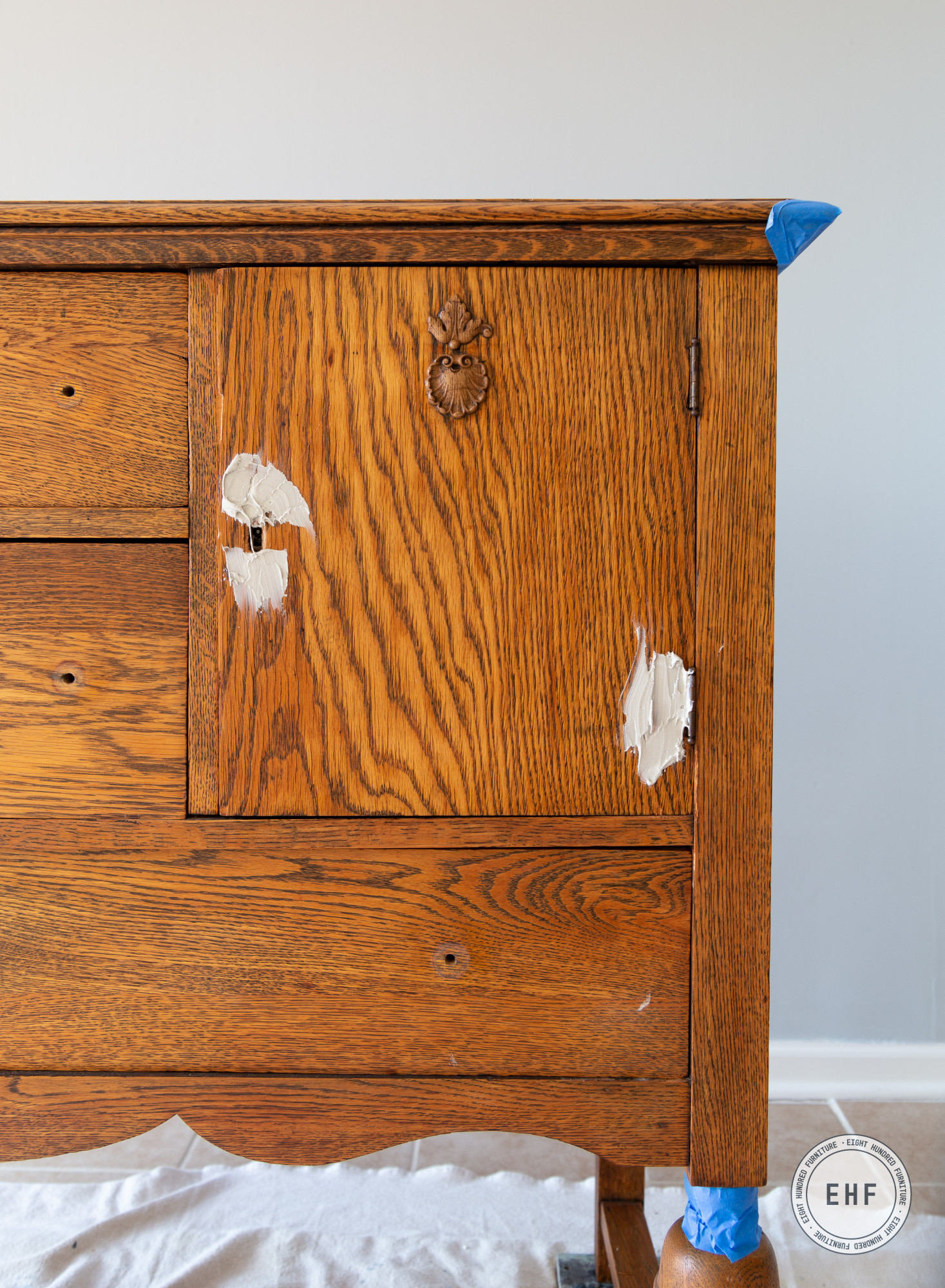 Bondo around keyhole and hinge of oak buffet