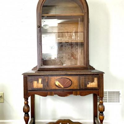Vintage china cabinet with damaged veneer