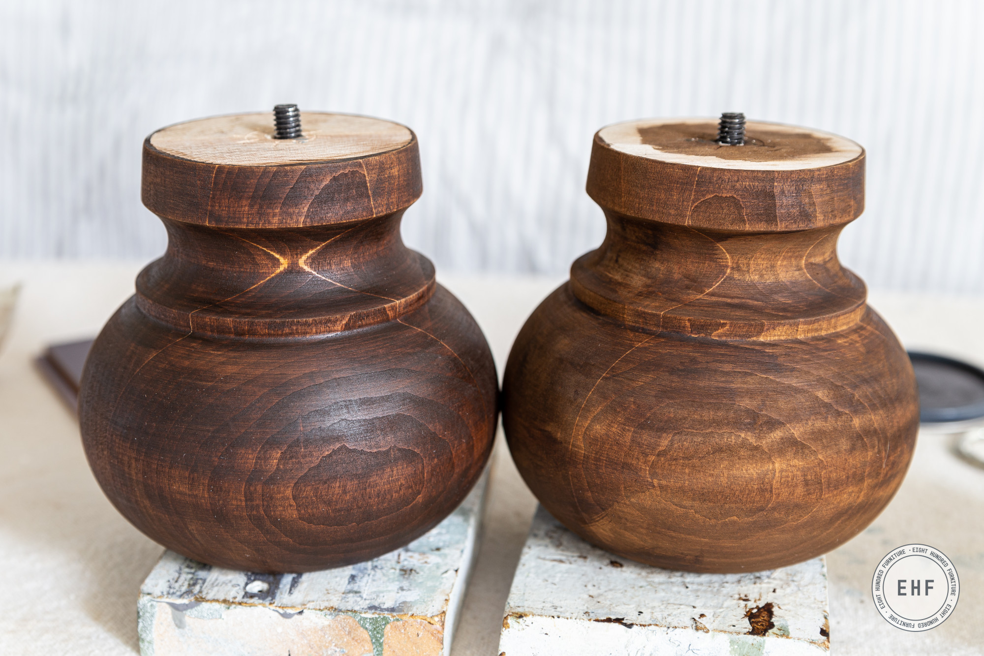 One and two coats of Antique Brown Water Based Wood Stain on turned bun feet