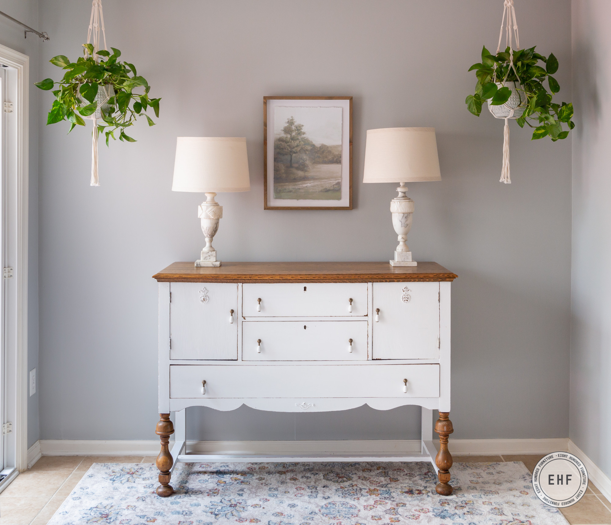 Macrame plant hangers painted in MOra Milk Paint by Miss Mustard Seed above an antique oak buffet painted in General Finishes Brushable White Enamel Flat by Eight Hundred Furniture