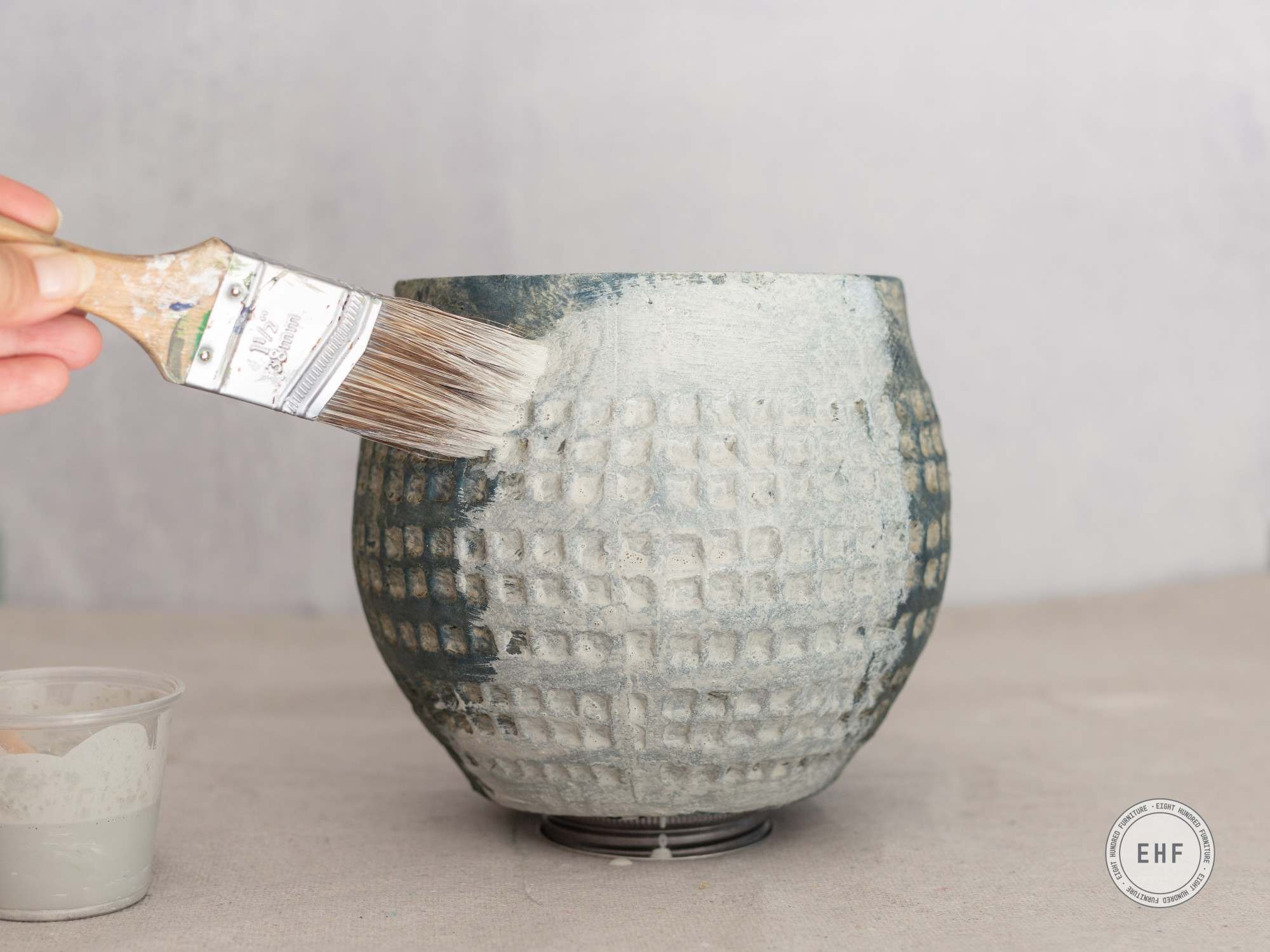 Painting Mora Milk Paint onto ceramic pot by Eight Hundred Furniture