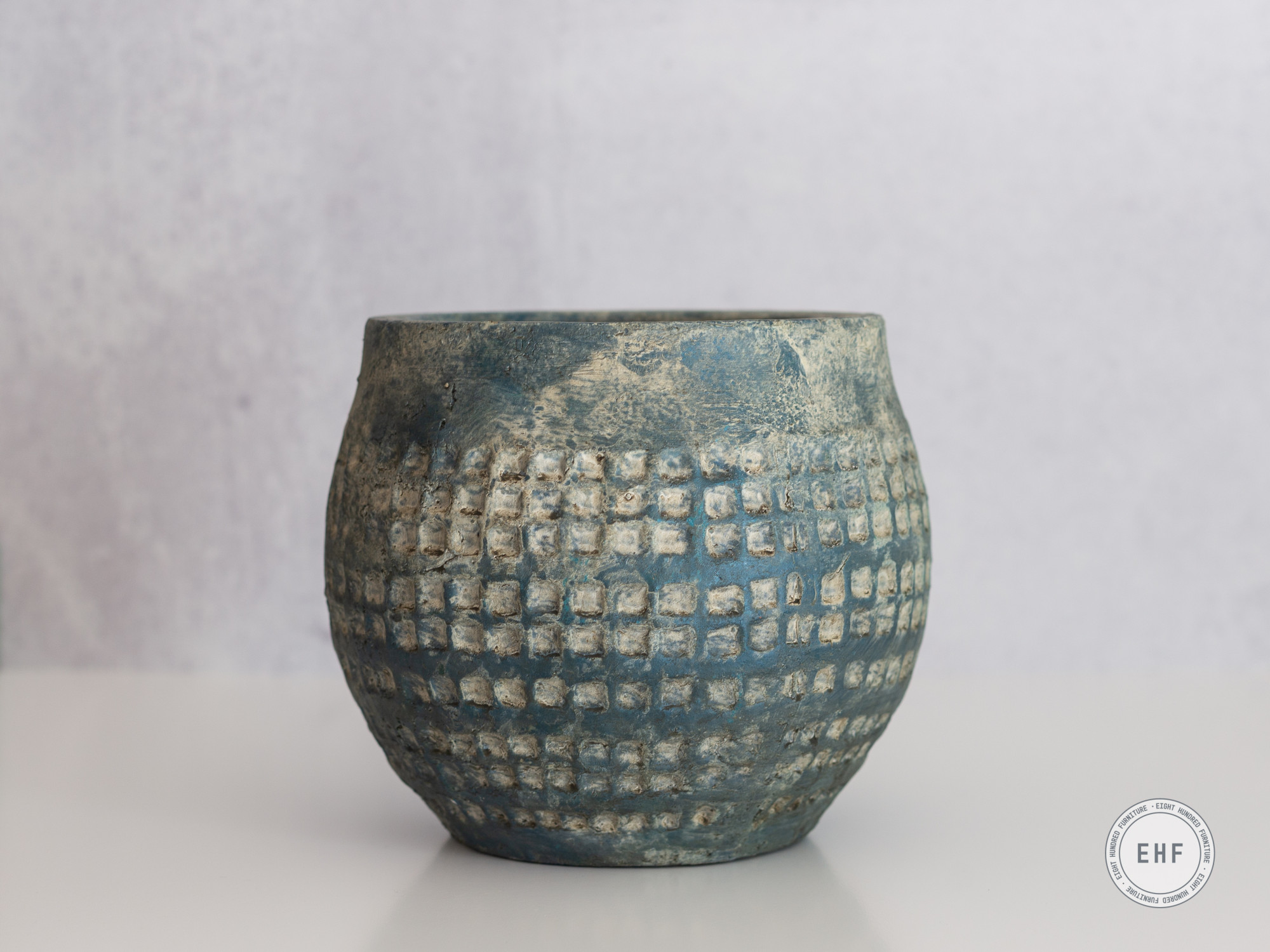 Teal ceramic pot with honeycomb pattern