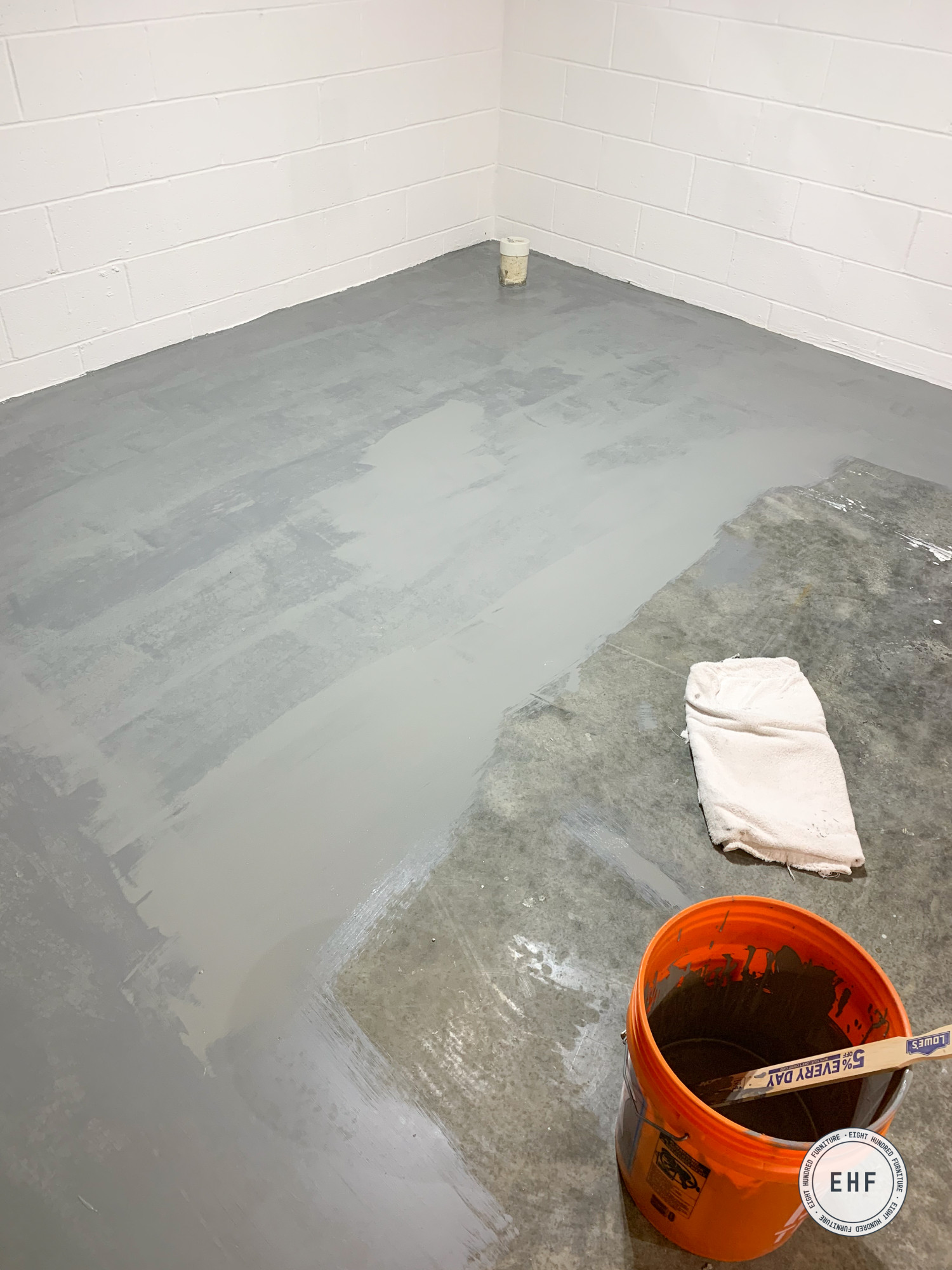 painting the concrete floor of the basement workshop in Drylok's Dover Gray