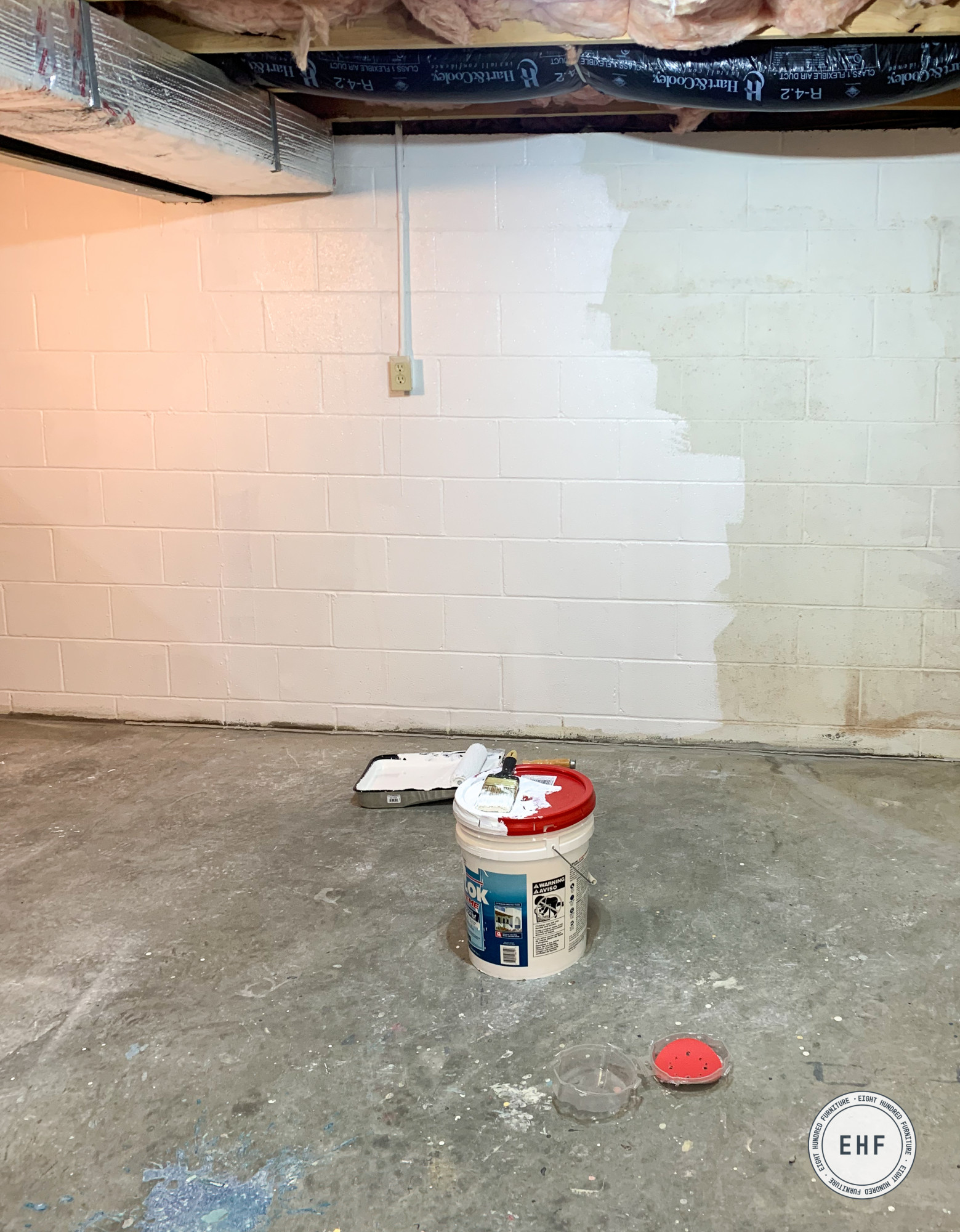 painting the cinder block walls of the basement workshop in Drylok