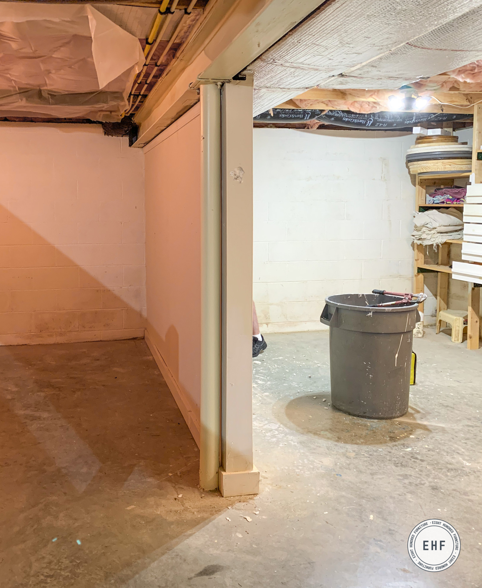 the dividing wall in the unfinished basement workshop